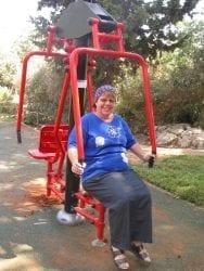 Woman sitting on exercise machine