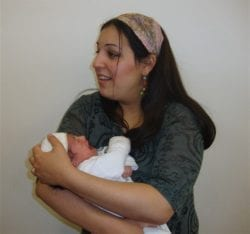 Sussya Woman holding a baby