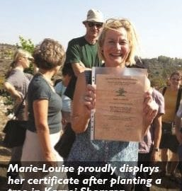 Marie-Louise holding certificate