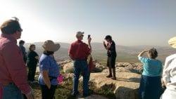 Sondra Baras speaks to a tour group at 3 Seas Outlook
