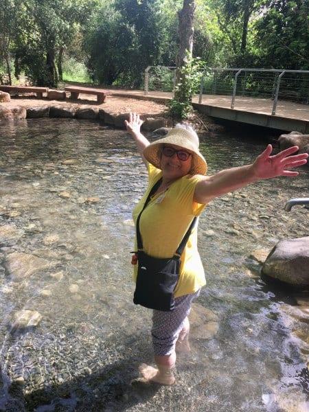 CFOIC tour participant wading at Tel Dan